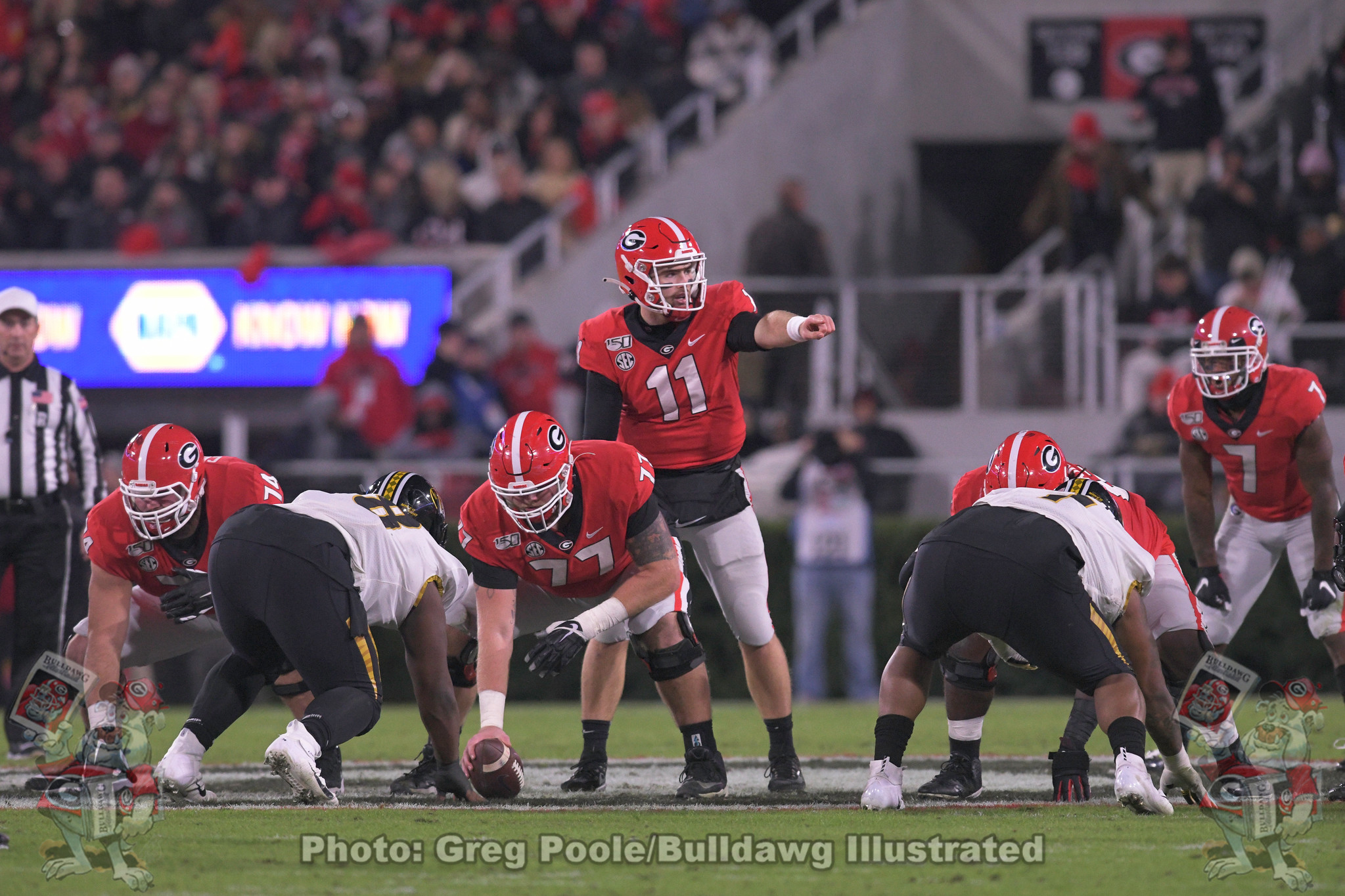 Cade Mays (77) under center