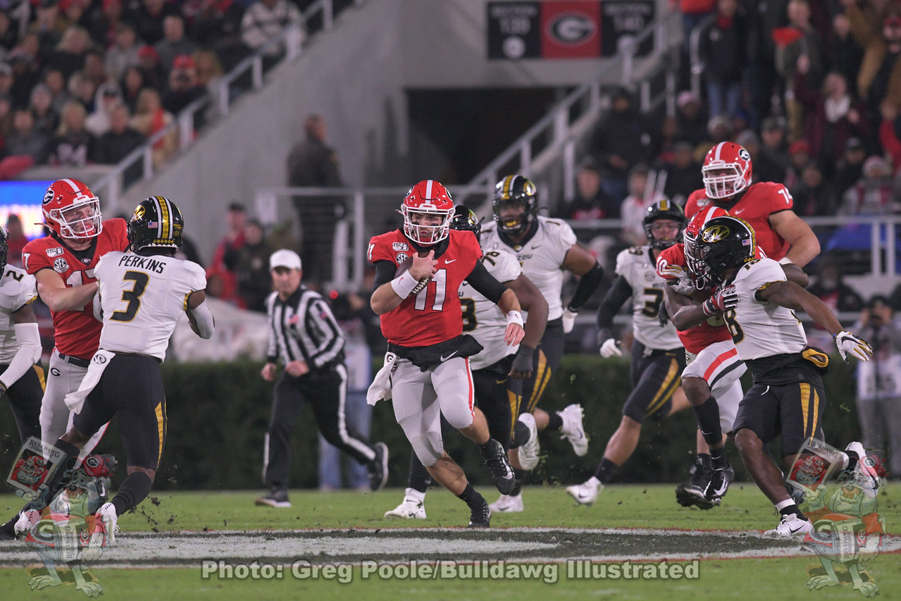 Jake Fromm (11) scrambles for positive yardage during the first quarter of the Missouri game on Saturday, November 9, 2019
