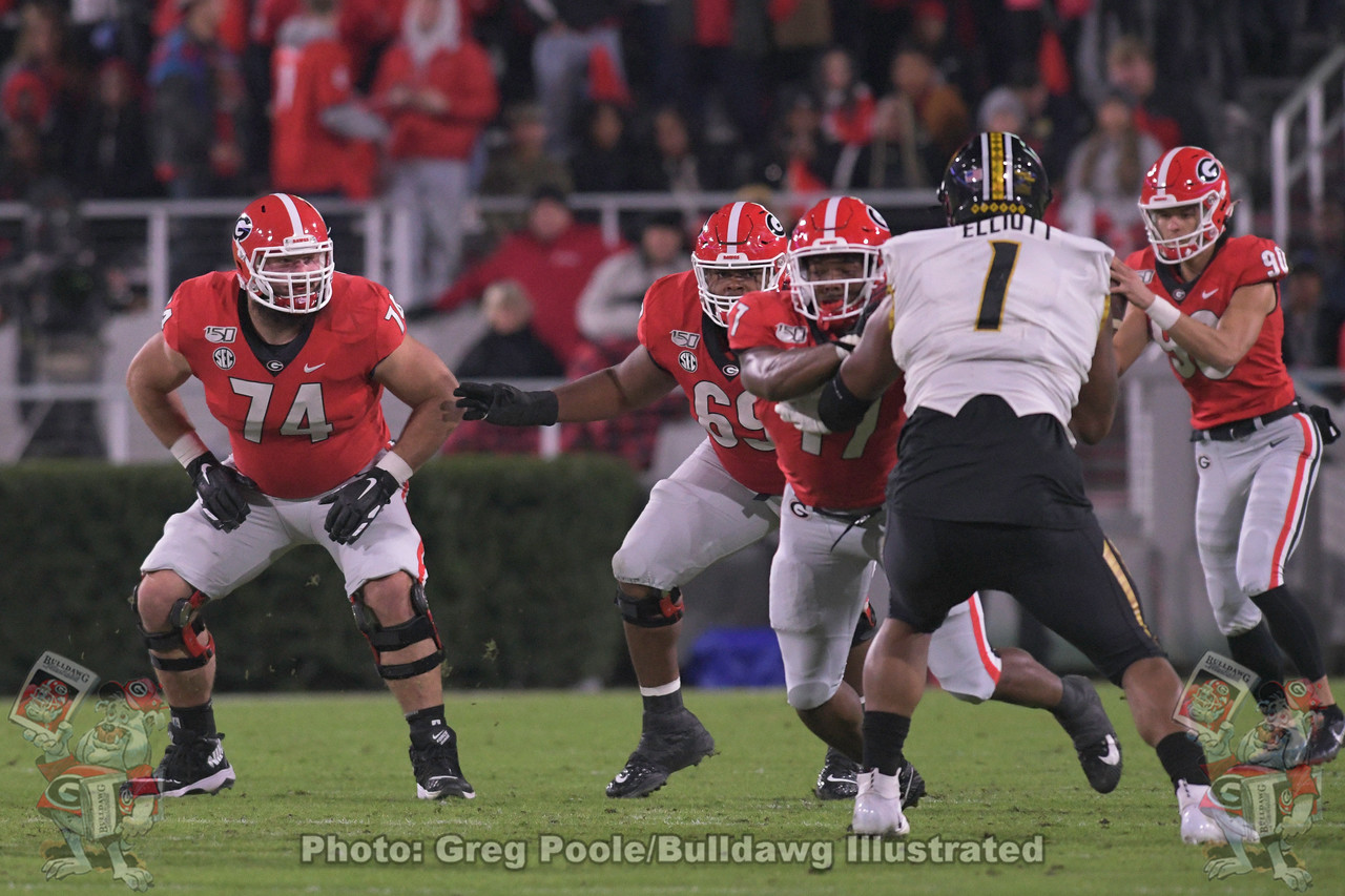 Ben Cleveland (74) and the o-line block as punter Jake Camarda (90) receives the snap. first-quarter, Georgia vs. Missouri,  Saturday, November 9, 2019