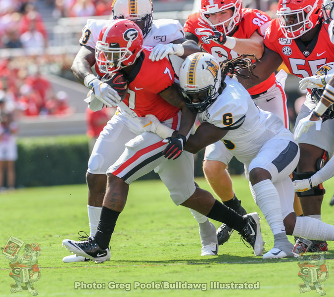 Georgia running back D'Andre Swift (7) carries Murray State defenders in the first half of Saturday's game, Sept. 7, 2019