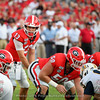 Stetson Bennett (13) gets ready to receive the snap from Warren Ericson (50)