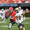WR George Pickens (1) lays out to snatch a 43-yard pass reception from QB Jake Fromm
