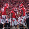 D'Andre Swift (7) celebrates with Lawrence Cager (15) and Matt Landers (5)