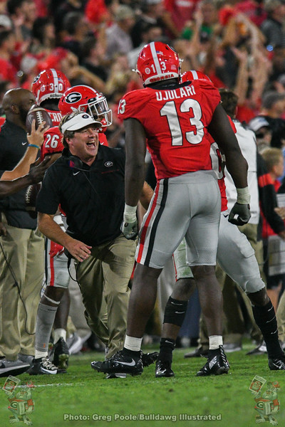 Georgia head coach Kirby Smart celebrates with the Dawgs' defense after J.R. Reed intercepts Ian Book during the fourth quarter of the Notre Dame game, Saturday, Sept. 21, 2019