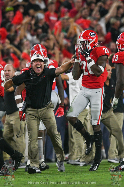 Kirby Smart celebrates with J.R. Reed (20) after the defense gets a turnover against Notre Dame, Saturday, September 21, 2019
