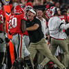 An excited and overjoyed Kirby Smart congratulates J.R. Reed (20) on his interception