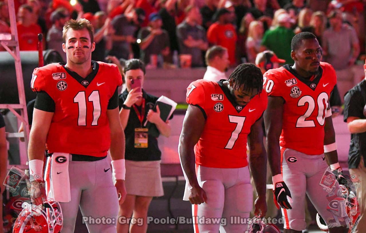 UGA QB Jake Fromm (11), RB D'Andre Swift (7), and safety J.R. Reed (20), captains for the Notre Dame game, Saturday, September 21, 2019