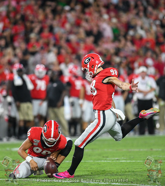Rodrigo Blankenship (98) with the PAT and Jake Camarda (90) with the hold