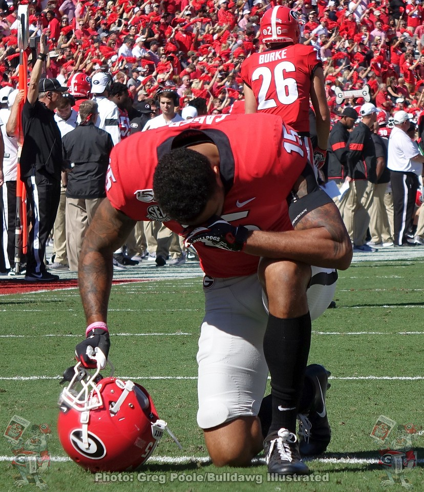 Lawrence Cager takes a knee before the start of the South Carolina game,  Saturday, October 12, 2019