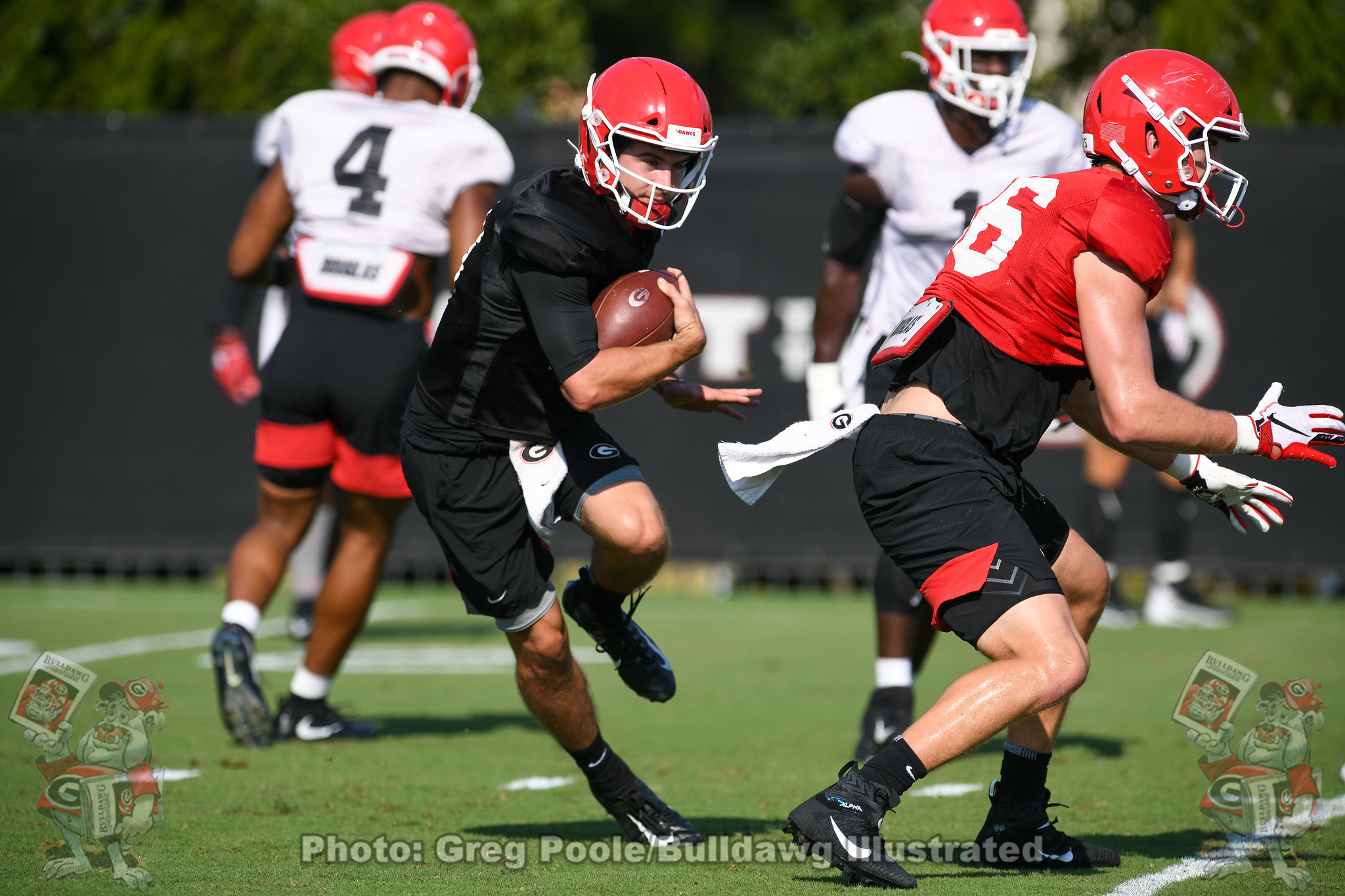Georgia quarterback Stetson Bennett IV participating in drills during fall camp.