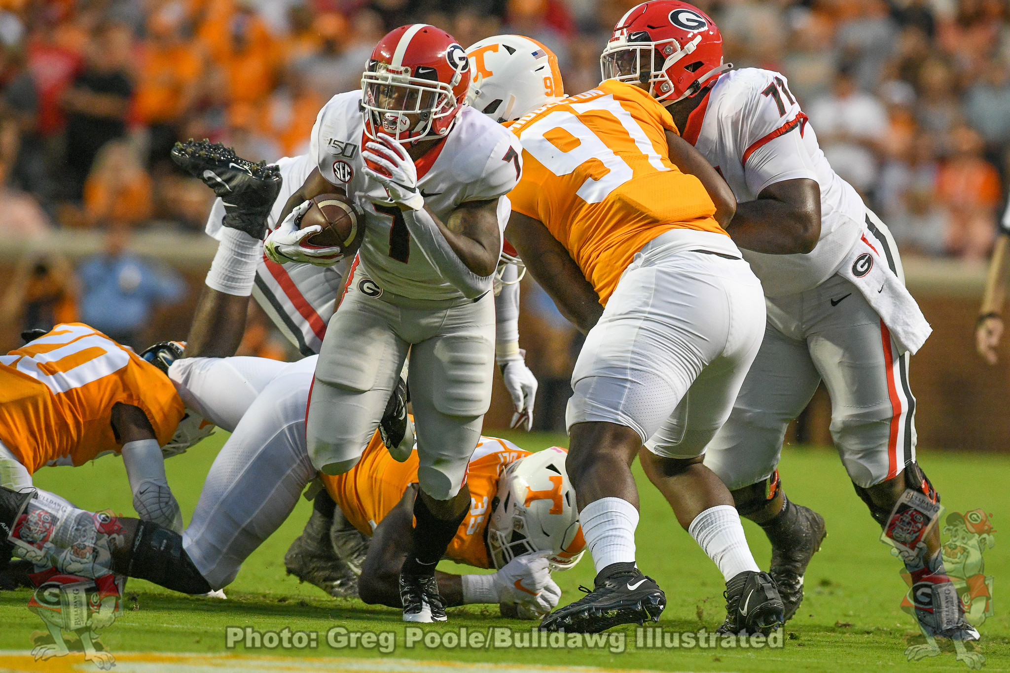 D'Andre Swift (7) breaks a tackle on a run during the first quarter against Tennessee in 2019.