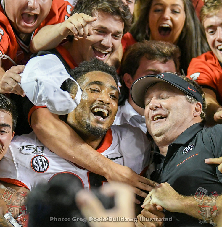 Brian Herrien (35) and Kirby Smart celebrate with fans after the 43-14 win,  Georgia vs. Tennessee game, Saturday, October 5, 2019