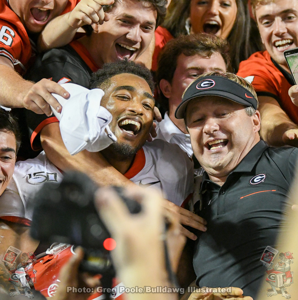 Senior running back Brian Herrien (35) and head coach Kirby Smart celebrate with teammates and fans after Georgia's 43-14 victory in Neyland Stadium over Tennessee on Saturday, October 5, 2019.