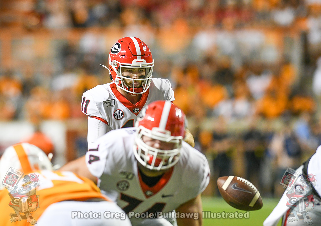 Jake Fromm (11) takes the snap from center during the second quarter of the Tennessee game on Saturday, October 5, 2019