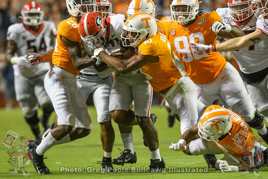 Brian Herrien (35) fights for extra yards during the second quarter of the Tennessee game on Saturday, October 5, 2019