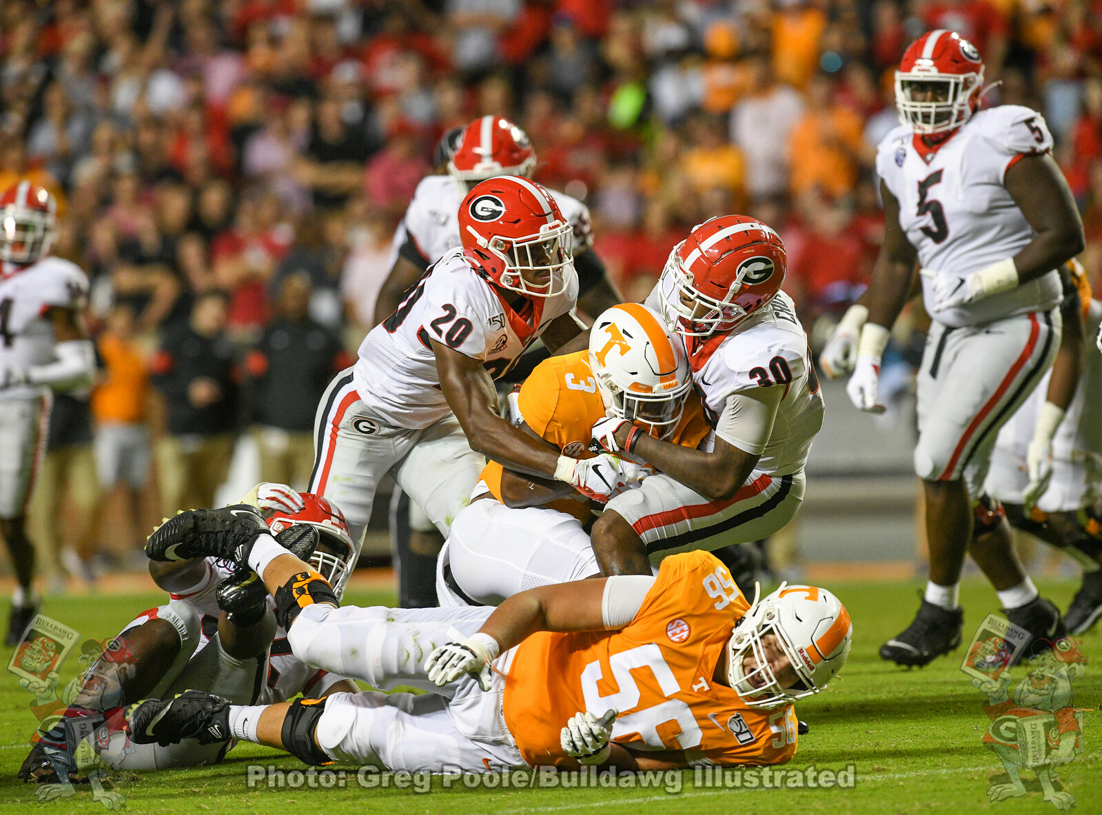 J.R. Reed (20) and Tae Crowder (30) tackle Vols' running back Eric Gray.