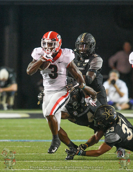 Zamir White escapes Commodore defenders during the third quarter, UGA vs. Vanderbilt, August 31, 2019.