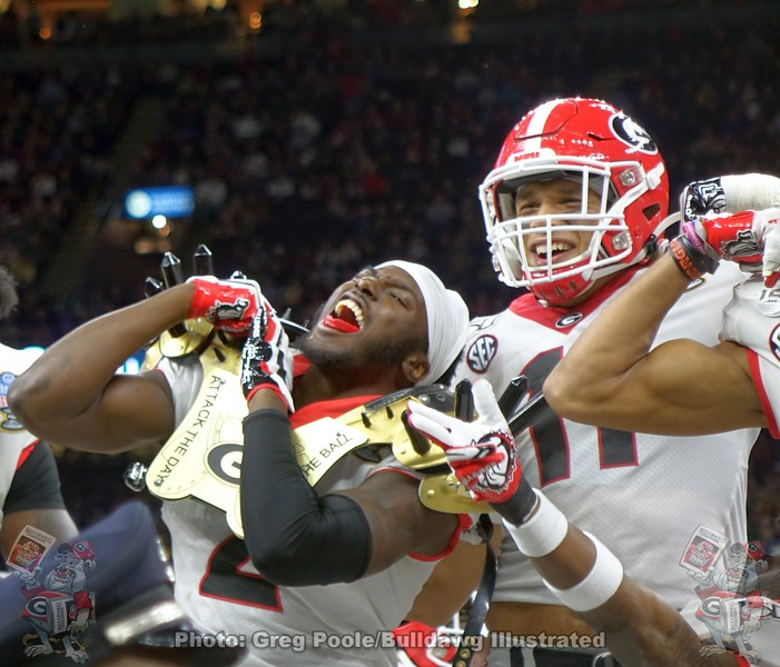 """UGA safety Richard Lecounte (2) dons the """"Savage Spike Pads"""" after intercepting the Baylor QB. Also shown is Jermaine Johnson (11)"""