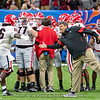 Matt Luke and Solomon Kindley (66). Also shown, Cade Mays (77)