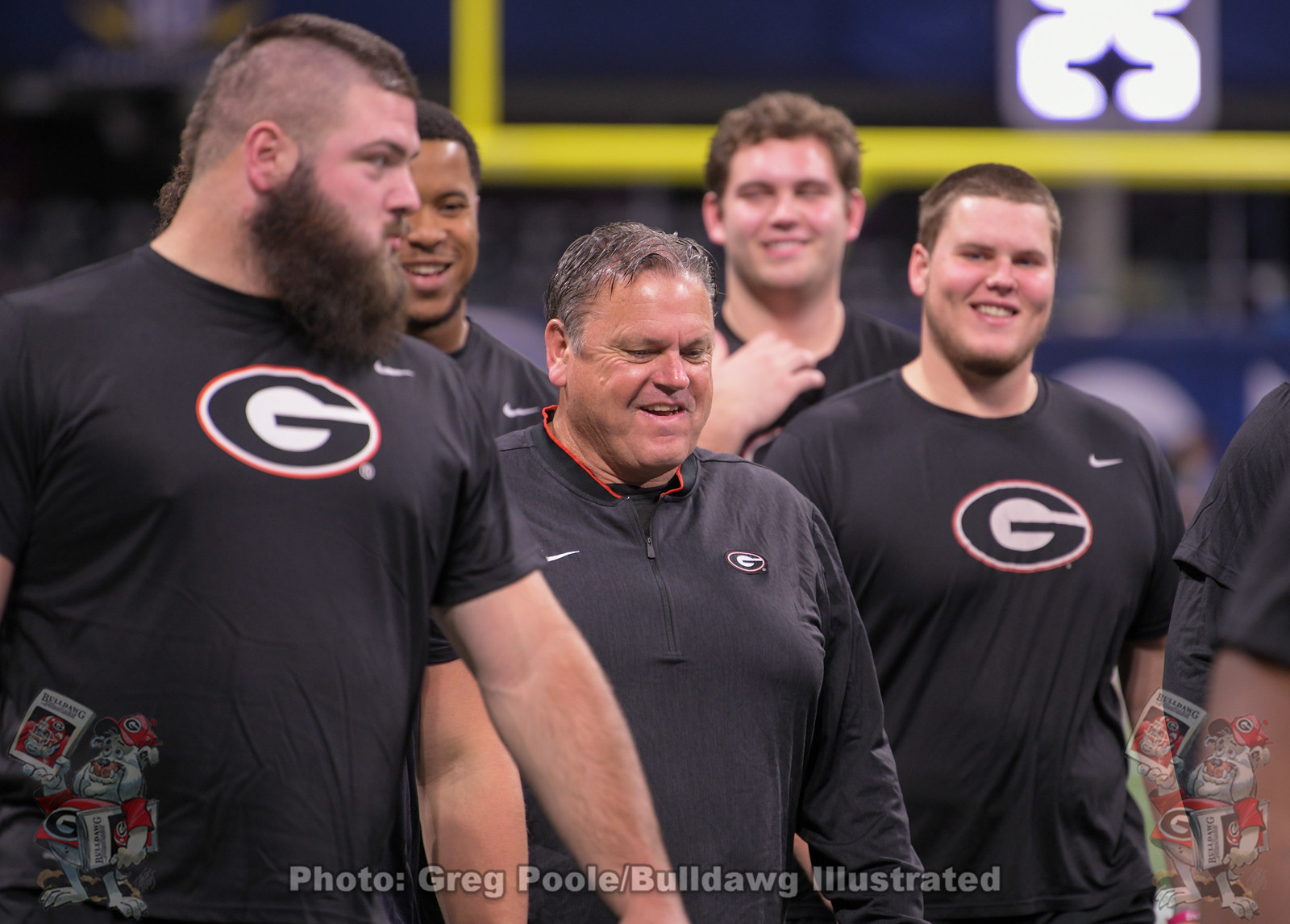 UGA assistant coach Sam Pittman with members of his offensive line during Friday's team walk-through of Mercedes-Benz Stadium, December 6, 2019