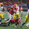 Tiger QB Joe Burrow (9) just escapes the grasp of the Dawgs' Travon Walker (44) and  Jordan Davis (99)