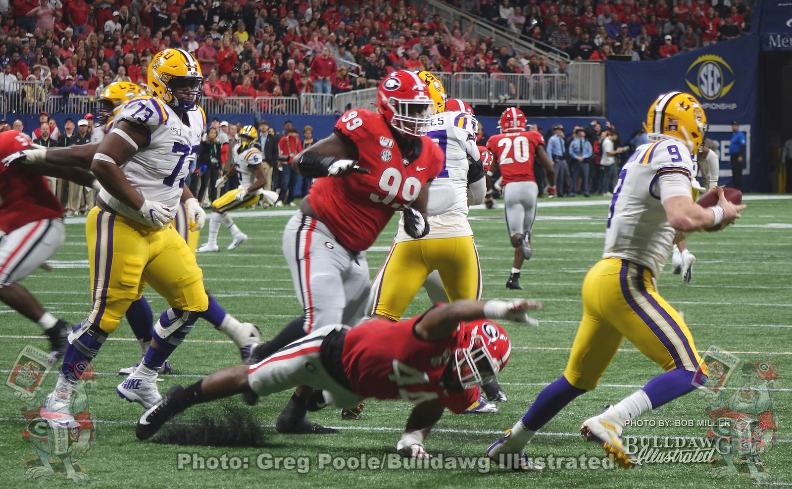 Tiger QB Joe Burrow (9) just escapes the grasp of the Dawgs' Travon Walker (44) and  Jordan Davis (99) during the third quarter of the 2019 SEC Championship game between Georgia and LSU on Saturday, December 7.