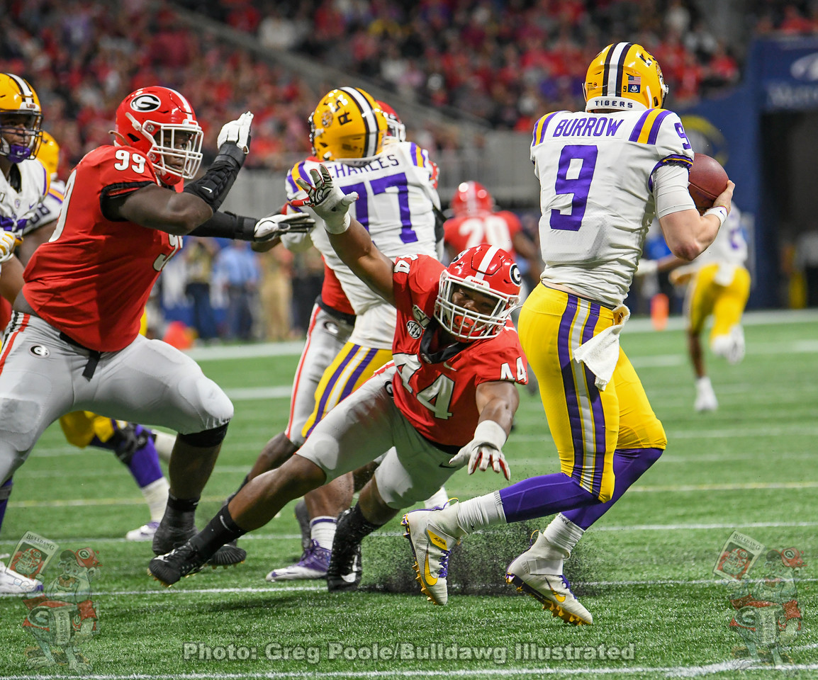 Tiger QB Joe Burrow (9) eludes Bulldog defensive linemen Travon Walker (44) and Jordan Davis (99) during the third quarter of the 2019 SEC Championship Game on Saturday, December 7, 2019