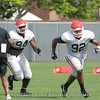 Michael Barnett (94) and Justin Young (92) running pursuit drill