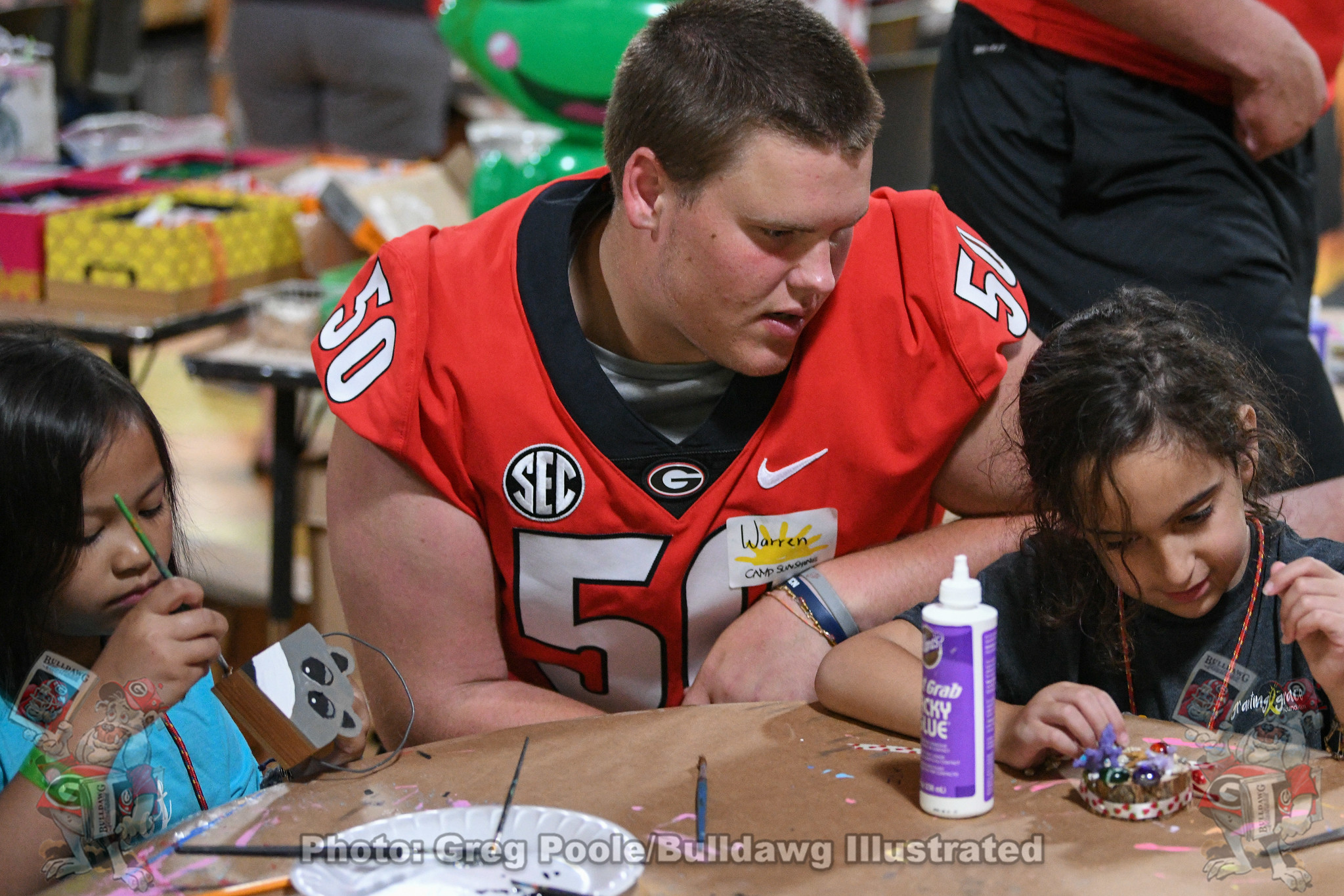 Georgia offensive lineman Warren Ericson interacts with campers during Georgia Football's visit to Camp Sunshine last summer.