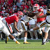 D'Andre Swift (7) and J.R. Reed (20) come very close to blocking a punt