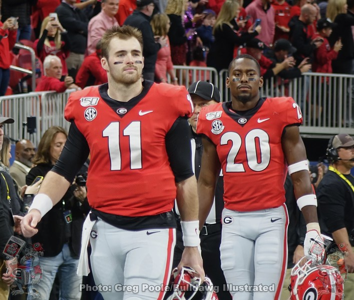 Jake Fromm (11) and J.R. Reed (20)