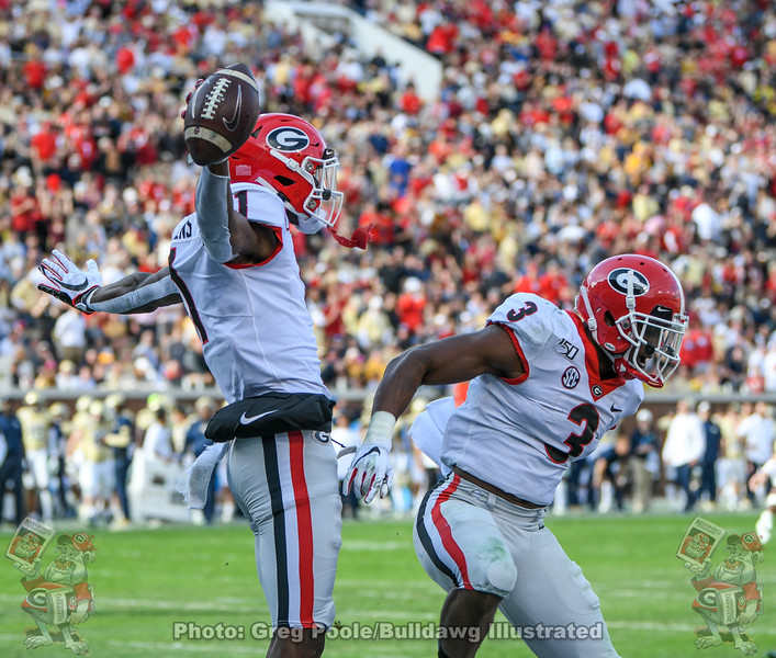 George Pickens (1) and Zamir White (3)