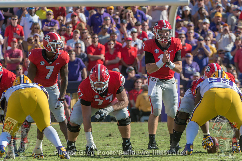 D'Andre Swift (7), Cade Mays (77) and Jake Fromm (11)
