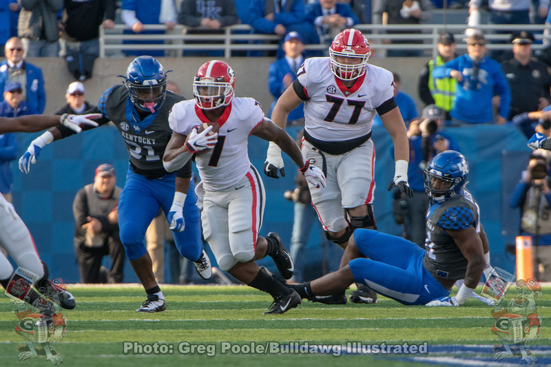 D'Andre Swift (7) and Cade Mays (77)