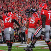 Justin Shaffer (54) and Isaiah Wilson (79) celebrate with Lawrence Cager (15)