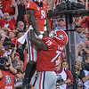 Riley Ridley (8) and Isaiah Wilson (79)
