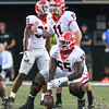 Brian Herrien (35), Jake Fromm (11) and Trey Hill (55)