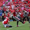 Jake Camarda (90) with the hold and Rodrigo Blankenship (98) with the PAT