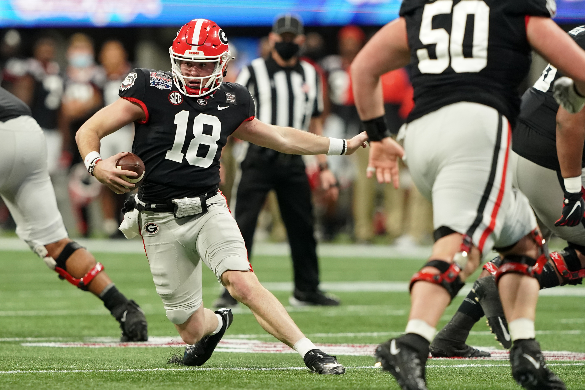 JT Daniels #18 of the Georgia Bulldogs runs the ball during the 2020 Chick-fil-A Peach Bowl NCAA football game between the Georgia Bulldogs and Cincinnati Bearcats, Jan. 1, 2021, in Atlanta. (Jason Parkhurst via Abell Images for the Chick-fil-A Peach Bowl)