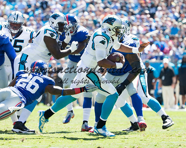 New York Giants defensive tackle Shaun Rogers (95), New York Giants strong safety Antrel Rolle (26), Carolina Panthers quarterback Cam Newton (1)
