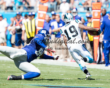 New York Giants tight end Larry Donnell (84), Carolina Panthers wide receiver Ted Ginn (19)