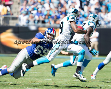 New York Giants defensive end Justin Trattou (69), Carolina Panthers wide receiver Ted Ginn (19)