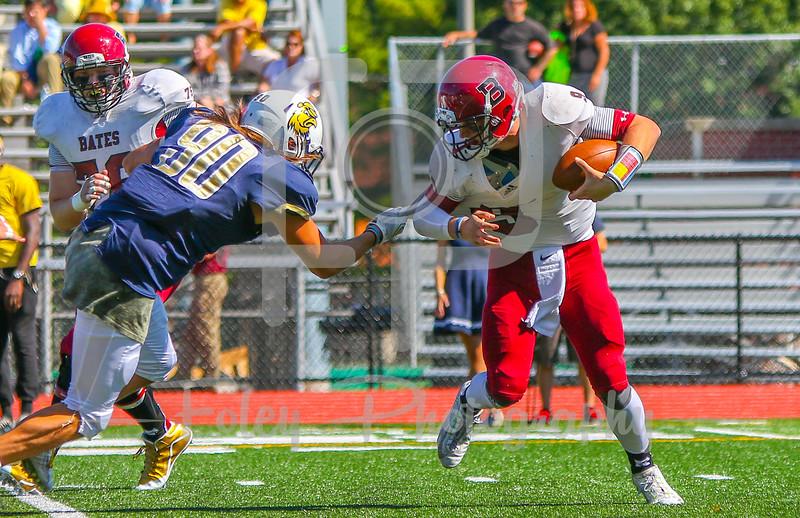 Trinity College Bantams defensive end Jameson Law (90) Bates College Bobcats quarterback Sandy Plashkes (9)