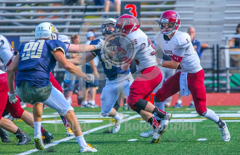 Bates College Bobcats running back Peter Boyer (35) Bates College Bobcats quarterback Sandy Plashkes (9)