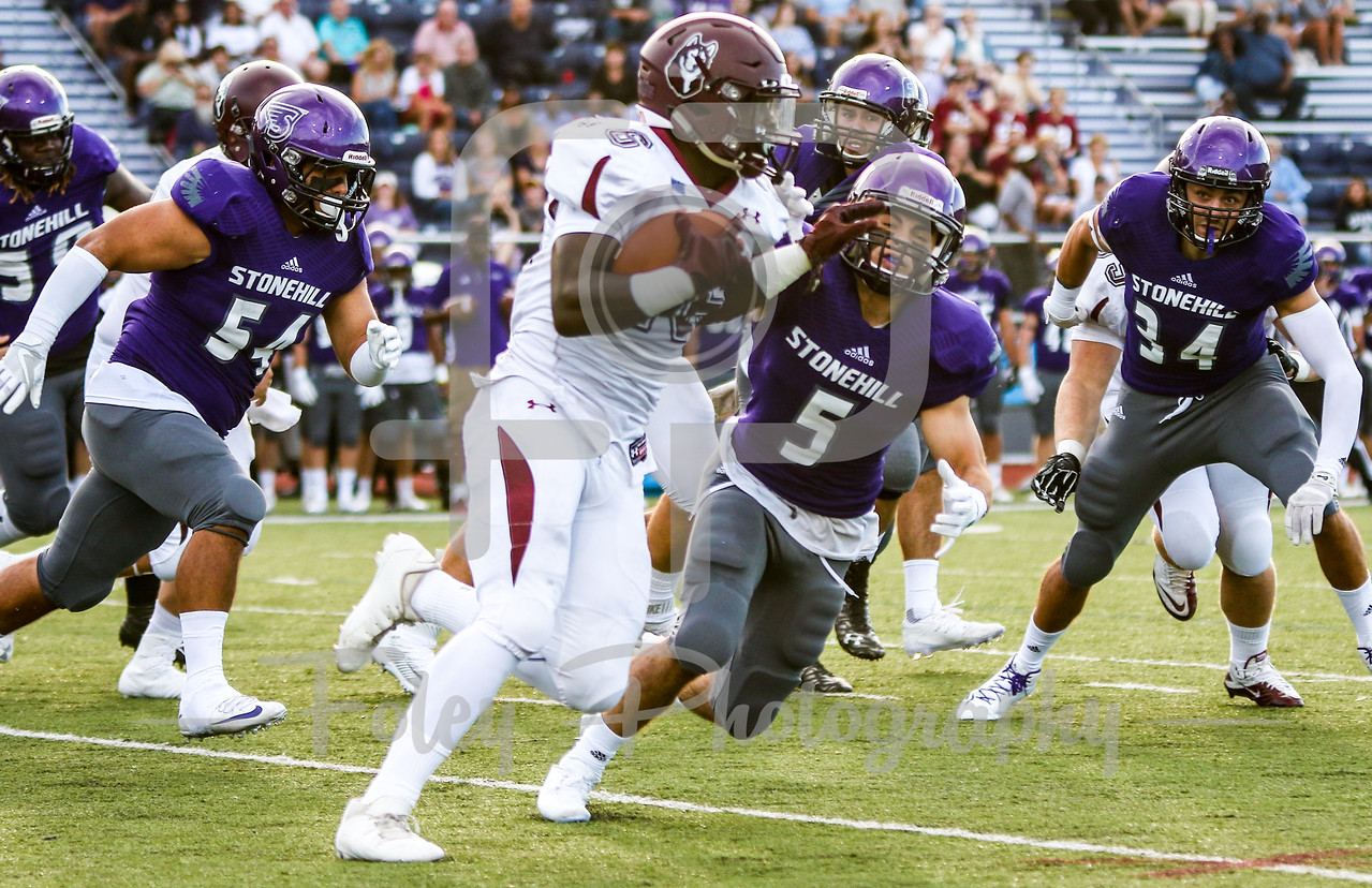 Bloomsburg Huskies running back Lawrence Elliott Jr. (26) Stonehill Skyhawks Nick Bona (5)