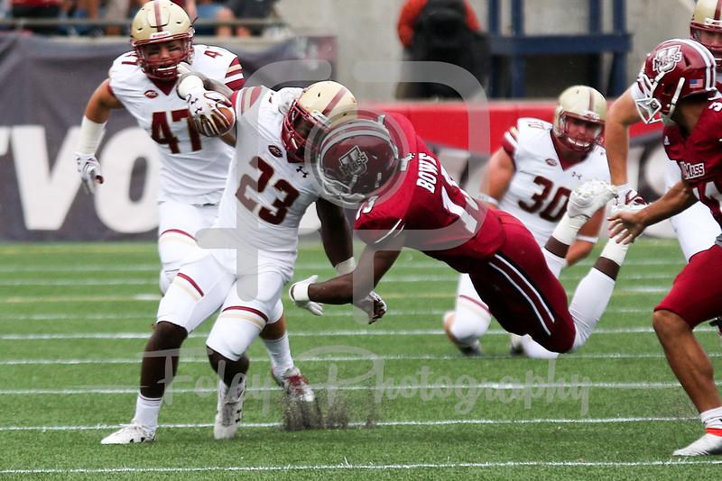 Boston College Eagles running back Myles Willis (23) Massachusetts Minutemen linebacker James Bowe Jr. (13)