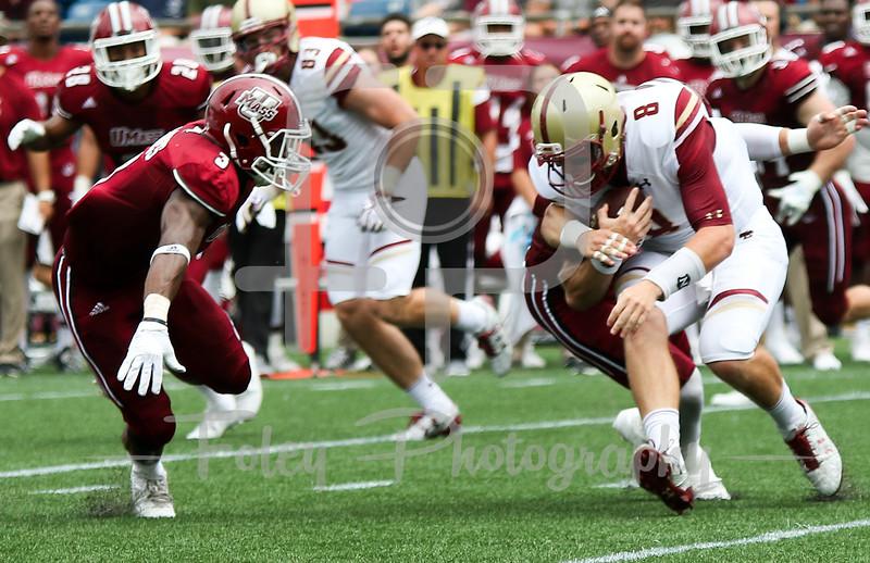 Boston College Eagles quarterback Patrick Towles (8) Massachusetts Minutemen linebacker Shane Huber (8)