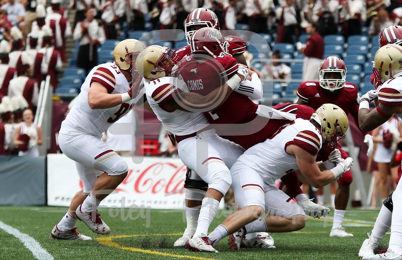 Boston College Eagles defensive end Wyatt Ray (11) Massachusetts Minutemen quarterback Ross Comis (2)