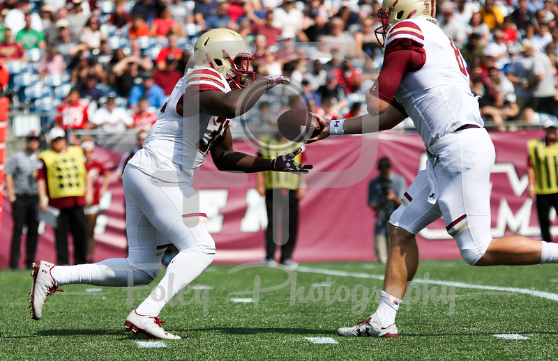 Boston College Eagles quarterback Patrick Towles (8) Massachusetts Minutemen safety Tyshaun Ingram (32)