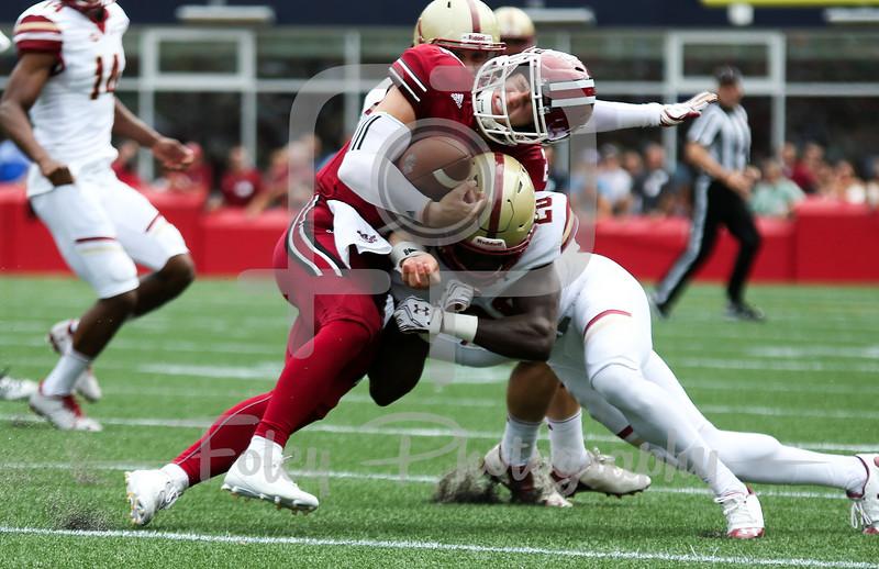 Massachusetts Minutemen quarterback Ross Comis (2) Boston College Eagles defensive back Isaac Yiadom (20)